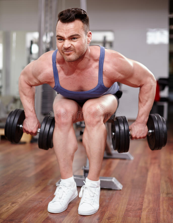 Download Man working with dumbbells stock image. Image of equipment - 39982963