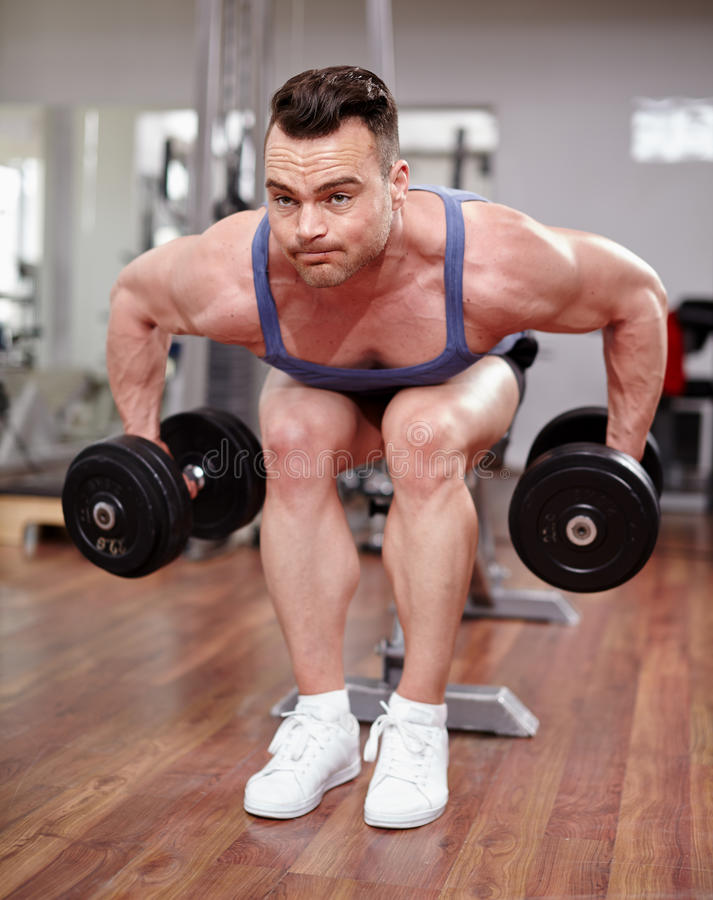 Man Working With Dumbbells Stock Photo