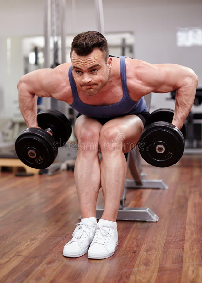Download Man working with dumbbells stock image. Image of attractive - 39983103