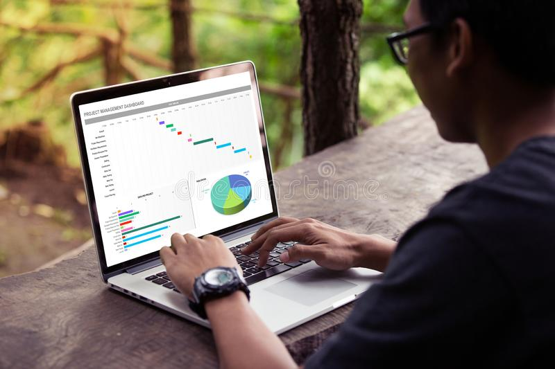 Man working with excel project dashboard on laptop / computer royalty free stock photos