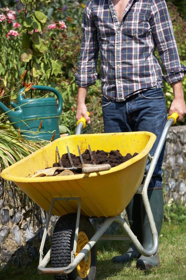 Man working in garden royalty free stock photos