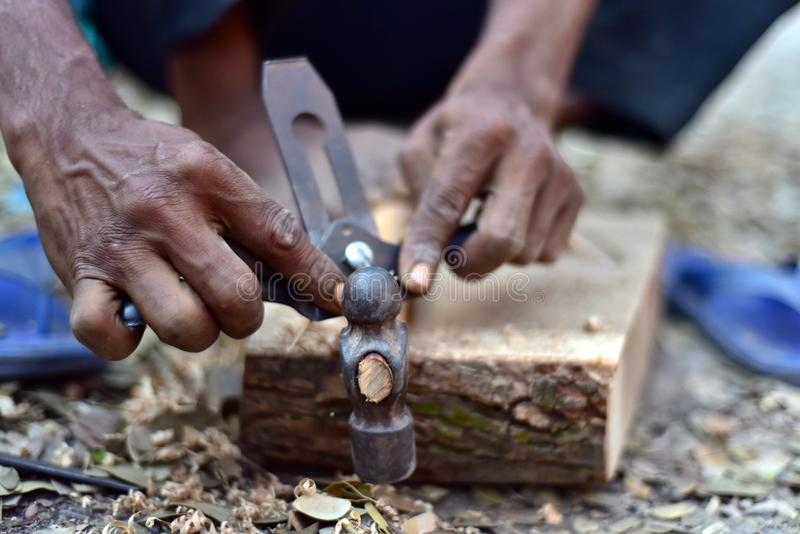 Man working with a hammer unique stock photograph. A carpenter is working with two hands to fix a hammer isolated stock photograph royalty free stock photos