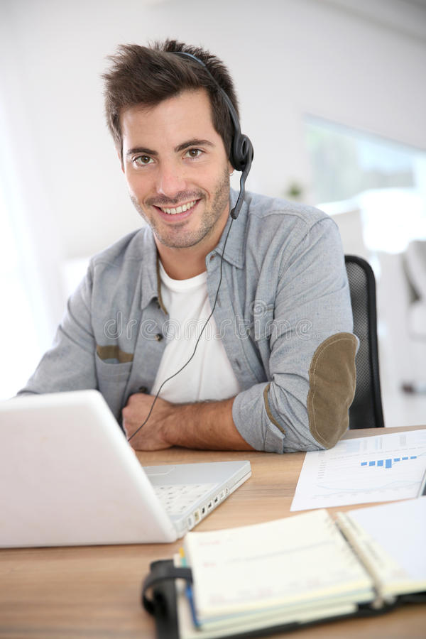 Man working with headset on royalty free stock photography