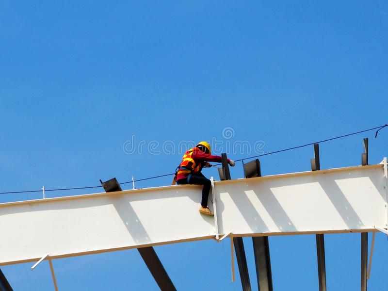 Man Working on the Working at height. On blue sky royalty free stock photos