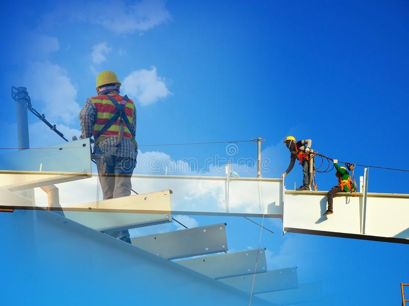 Man Working on the Working at height. On blue sky stock image