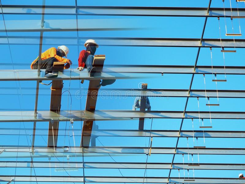 Man Working on the Working at height. On blue sky royalty free stock images