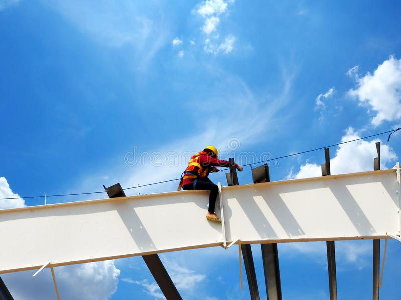 Man Working on the Working at height. On blue sky stock photos