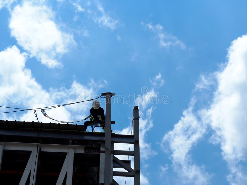 Man Working on the Working at height. On construction site stock photos