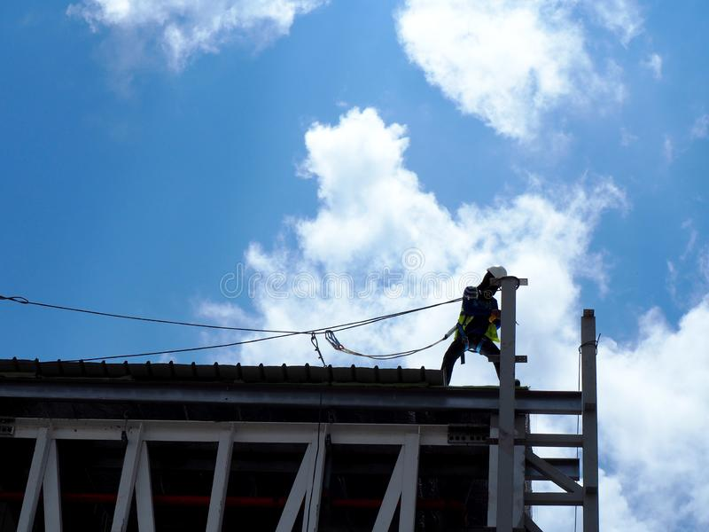 Man Working on the Working at height. On construction site royalty free stock photo