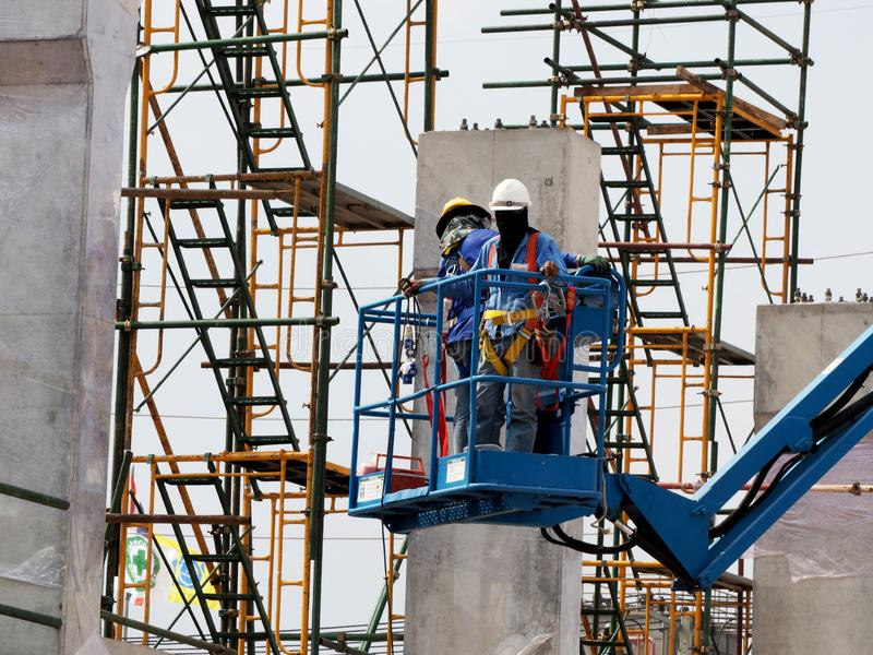 Man Working on the Working at height. On Construction site stock photography