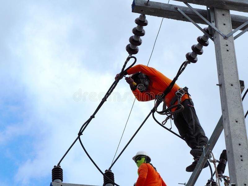 Man Working on the Working at height. Electrical work stock photos