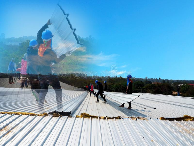 Man Working on the Working at height. On top roof stock photography