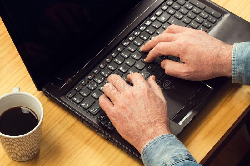 Man working with his laptop stock images