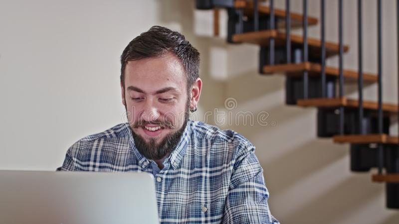 Man Working at Home on Laptop Computer. Close-up view of young man working at home on pc, win lottery, sukces shopping royalty free stock photos
