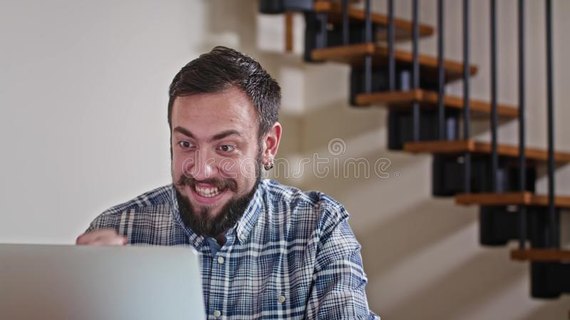 Man Working at Home on Laptop Computer. Close-up view of young man working at home on pc, win lottery, sukces shopping royalty free stock images