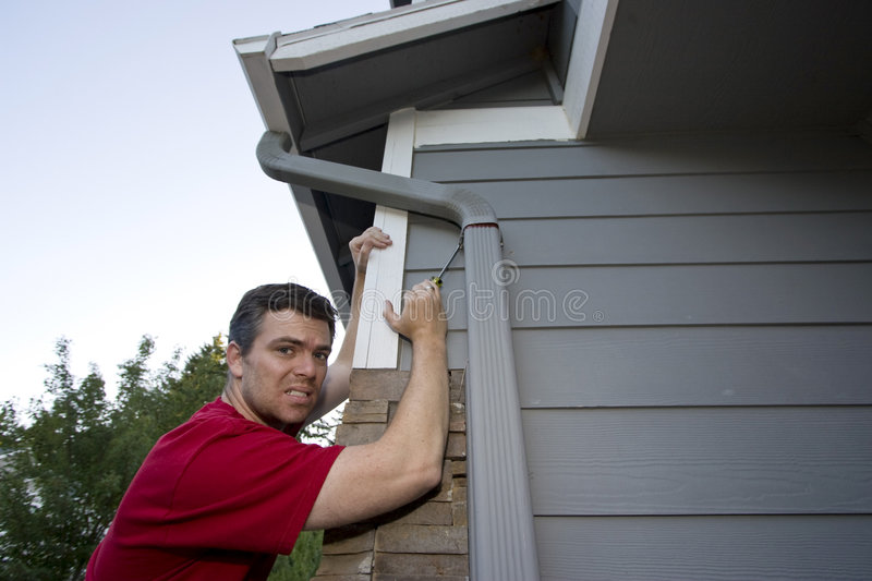 Man Working on House - Horizontal royalty free stock images