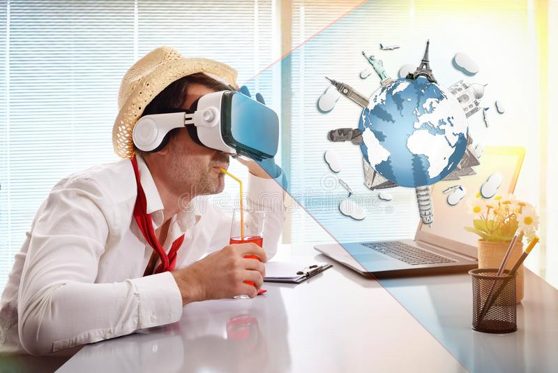 Man working imagining his vacation with vr glasses representation drinking royalty free stock images