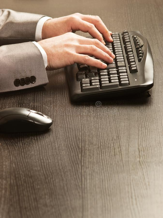 Man working with a keyboard and a mousse royalty free stock image