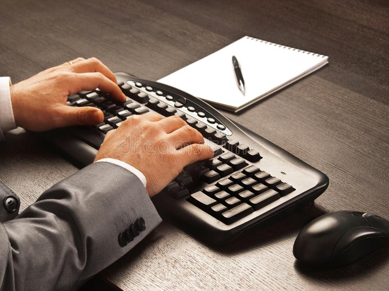 Man working with a keyboard and a mousse royalty free stock photos