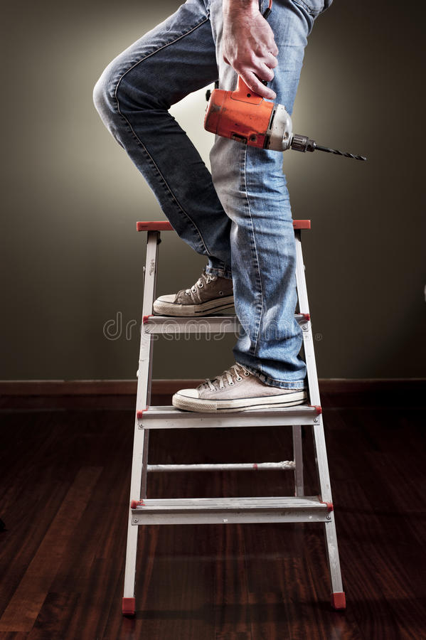 Man working on ladder stock photography