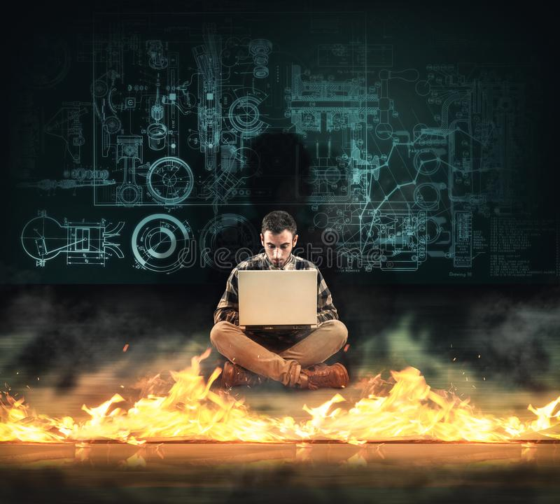 Firewall protection. Man working on laptop in front of a firewall. royalty free stock photo