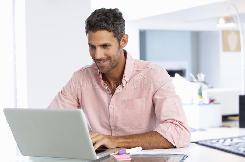 Man Working At Laptop In Home Office royalty free stock image
