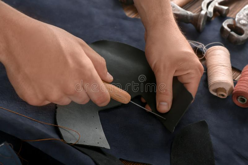 Man working with leather at factory royalty free stock photo