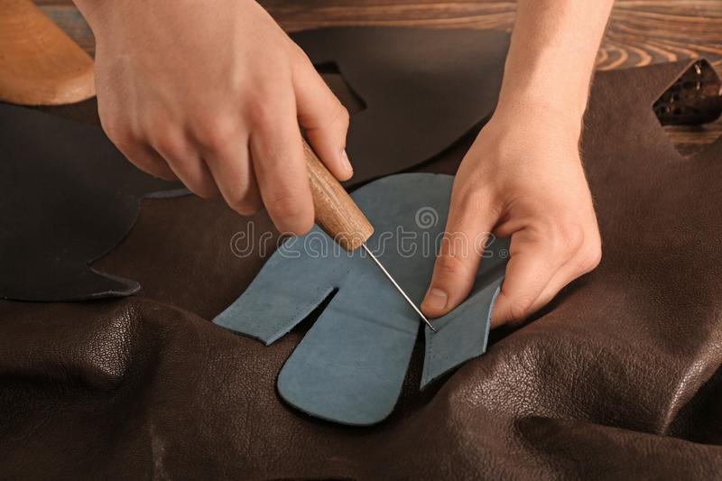 Man working with leather at factory royalty free stock photography