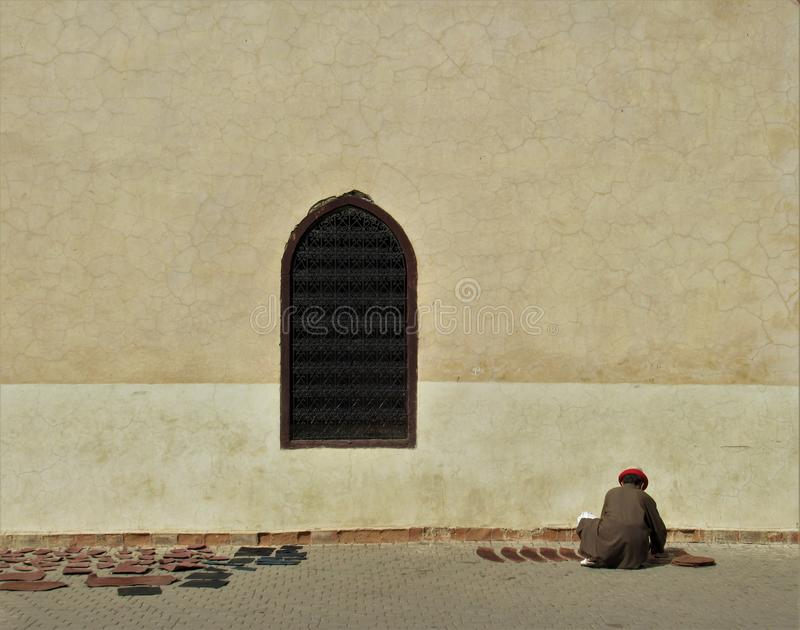 Man working with leather in Marrakesh.  stock photos