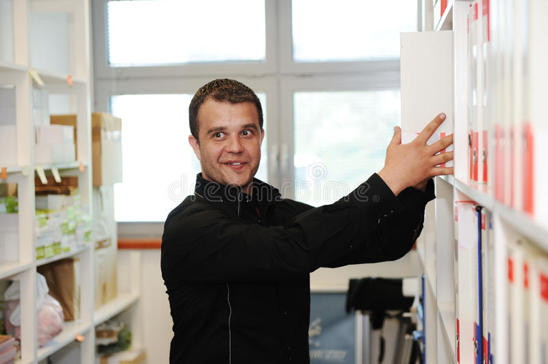 Download Man Working At Office Putting Folders Stock Photo - Image of casual, good: 23006608
