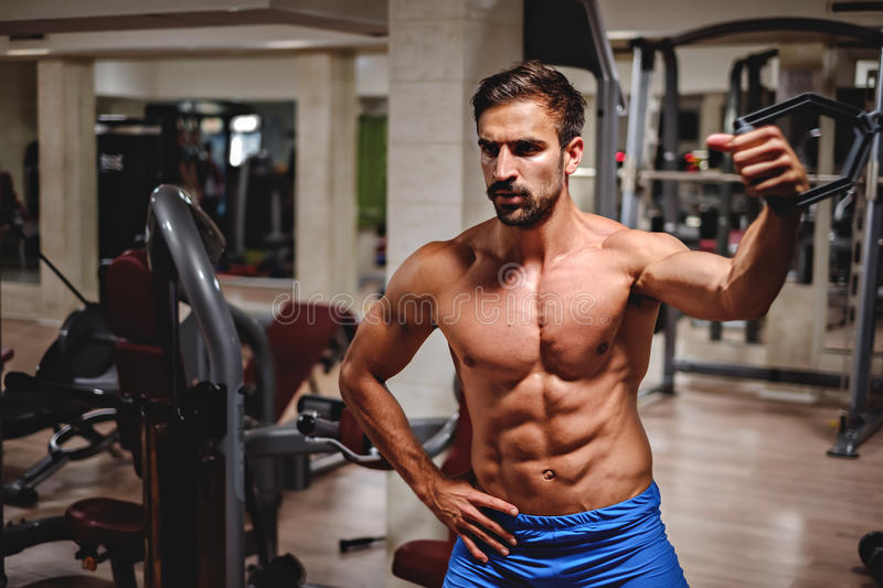 Man working out chest with one arm stock photo