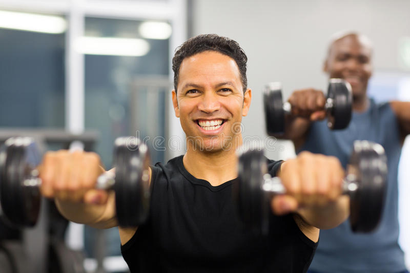 Man working out dumbbells stock photography