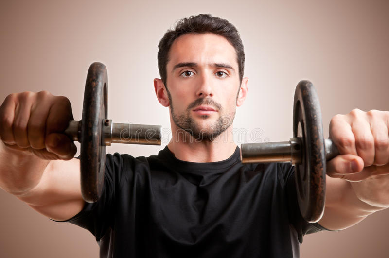 Download Man Working Out With Dumbbels Royalty Free Stock Photography - Image: 31318987