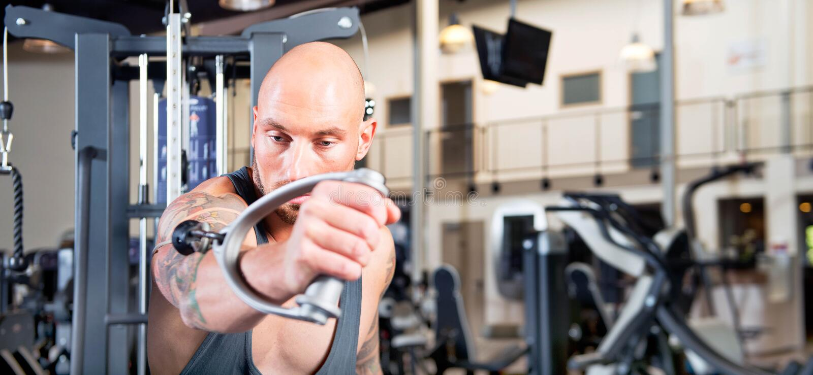 Man working out in a gym stock photo