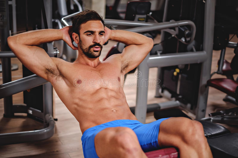 Man working out his abs. In the gym stock photography