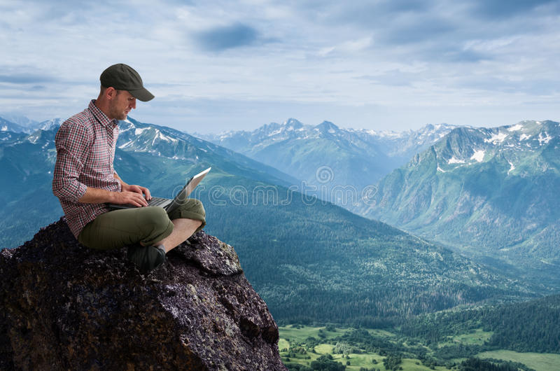 Man working outdoors stock photography