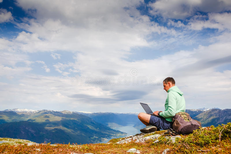Man working outdoors with laptop royalty free stock image