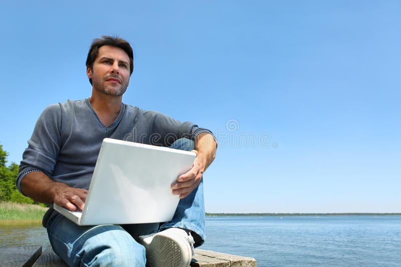 Man working on pier stock photo