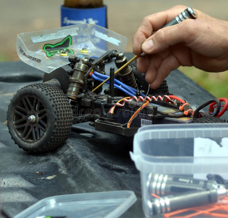 Man working on the radio controlled buggy car model. Sydney, Australia - December 14, 2014. Man working on the radio controlled buggy car model, internal stock image