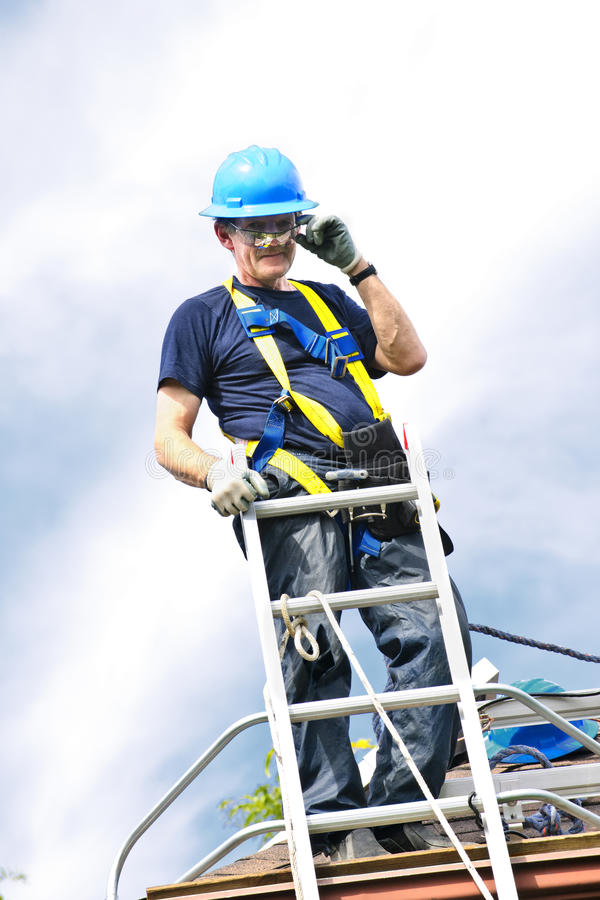 Man working on roof royalty free stock images