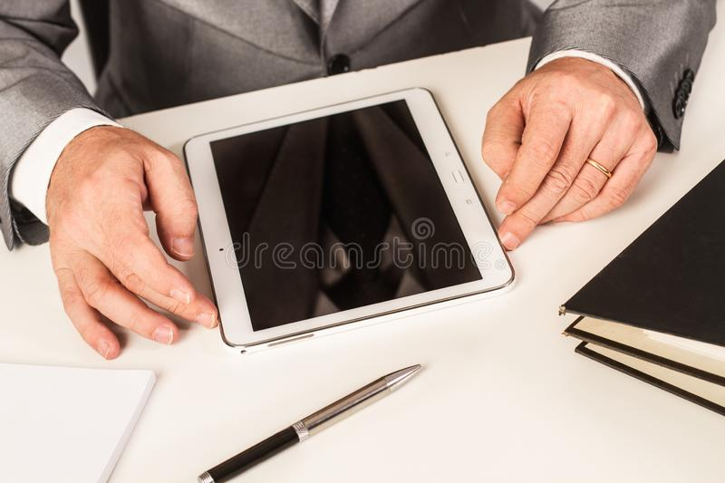Man working with a tablet royalty free stock photos