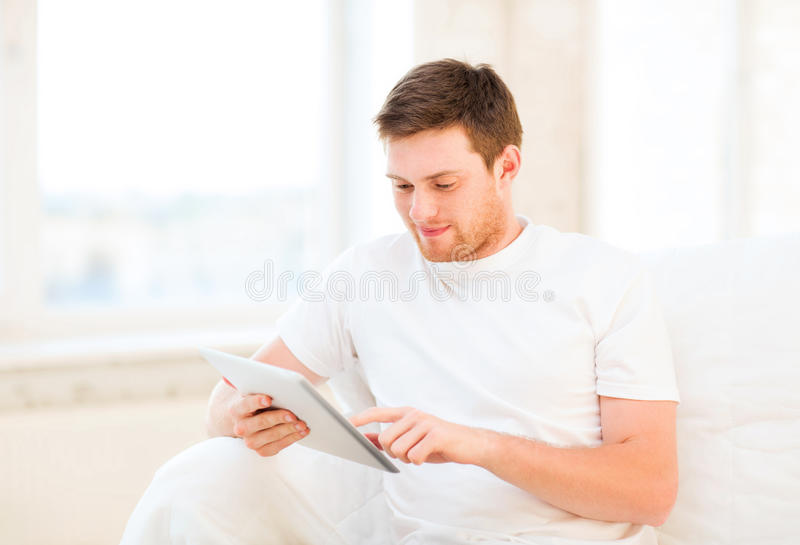 Download Man Working With Tablet Pc At Home Stock Photo - Image: 33079334