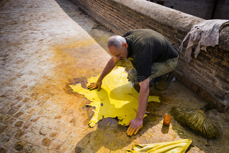 Man working in a tannery in the city of Fez in Morocco. Fez, Morocco - April 11, 2016: One man working in a tannery in the city of Fez in Morocco stock images