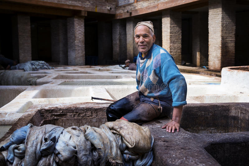 Man working in a tannery in the city of Fez in Morocco. Fez, Morocco - April 11, 2016: One man working in a tannery in the city of Fez in Morocco stock image