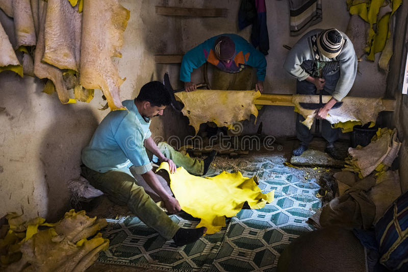 Man working in a tannery in the city of Fez in Morocco. Fez, Morocco - April 11, 2016: Tree man working in a tannerie in the city of Fez in Morocco stock images