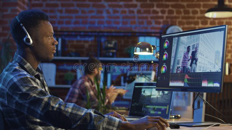 Man working on video edit stock photos