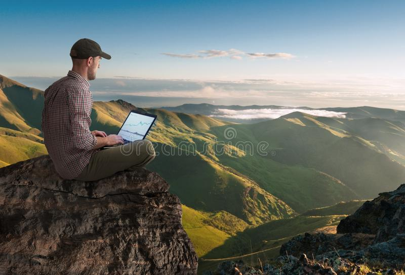 Man working wireless outdoors stock photography