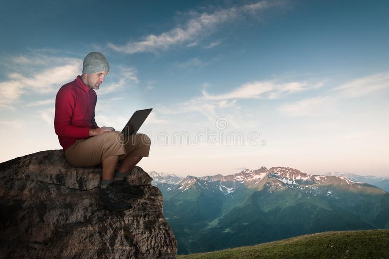 Man working wireless outdoors royalty free stock photography
