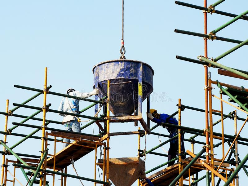Man Working on the Working at height. On blue sky stock photo