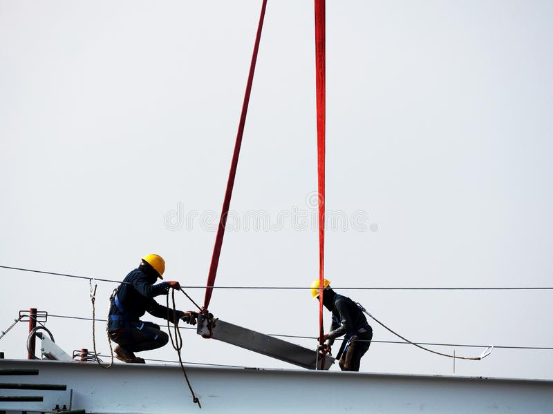 Man Working on the Working at height. On blue sky stock images